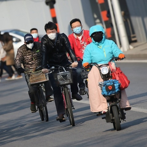 People wearing face mask are seen in Beijing, China on April 17, 2020, amid an outbreak of the new coronavirus COVID-19