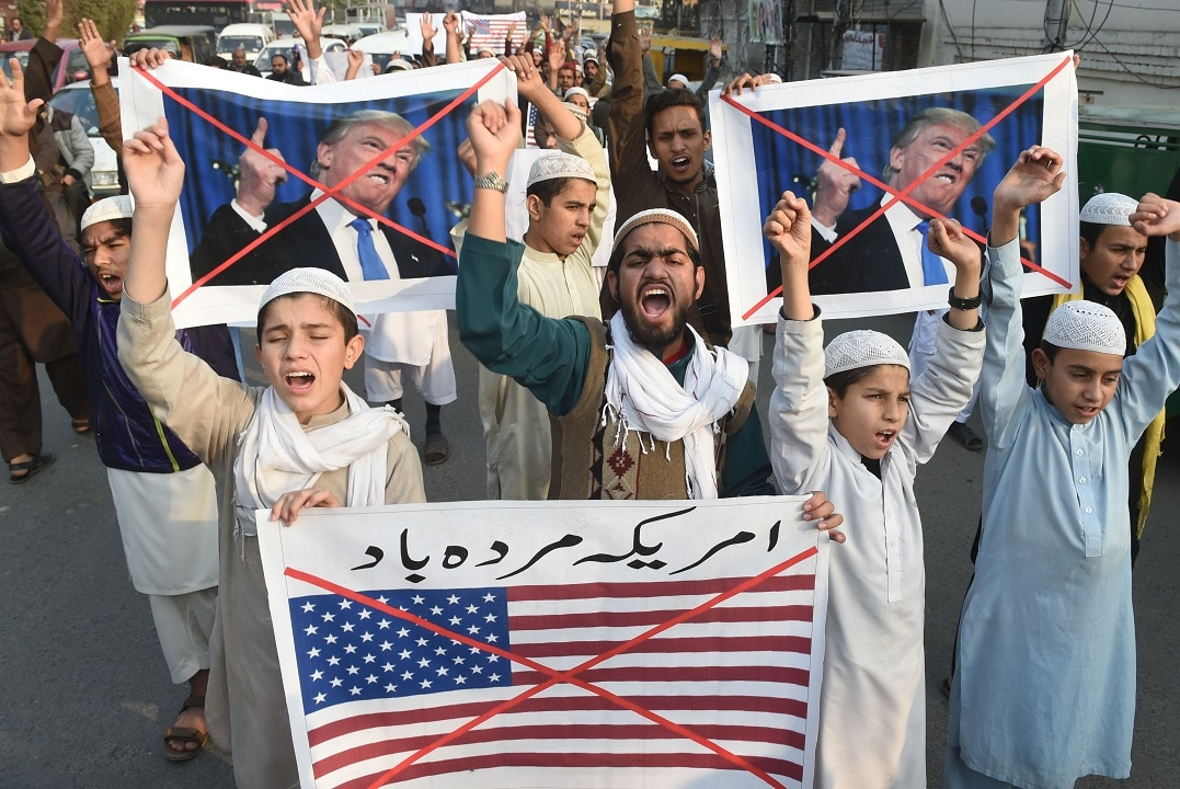 Pakistani demonstrators take part in a protest against US aid cuts in Lahore.