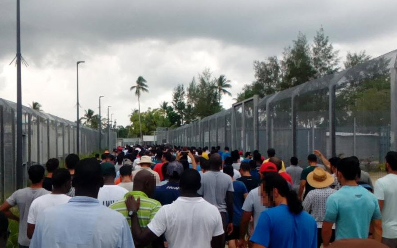 A photograph of a protest at Manus Island in wake of the death of Hamed Shamshiripour.