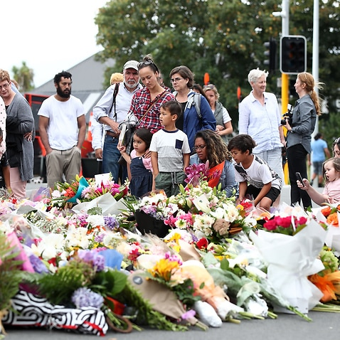 Mourners pay their respects at a makeshift memorial near the Masjid Al Noor mosque in Christchurch, New Zealand.