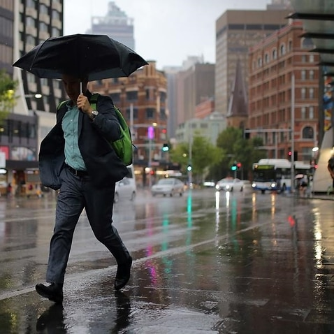 Pedestrians are seen in Sydney's CBD.