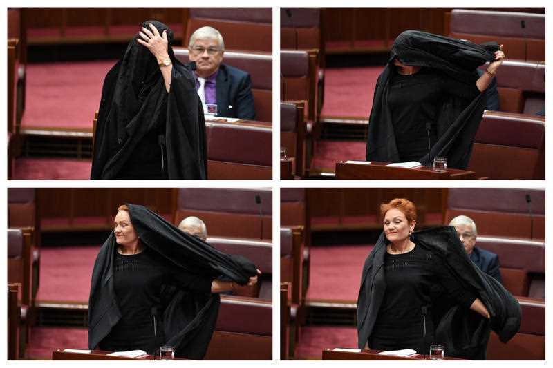 One Nation Senator Pauline Hanson takes off a burqa in the Senate.