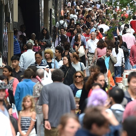 Huge crowds fill Pitt Street Mall and the CBD shopping district as they purchase their last minute christmas gifts on Christmas Eve in Sydney, Wednesday, Dec. 24, 2014. (AAP Image/Dean Lewins) NO ARCHIVING