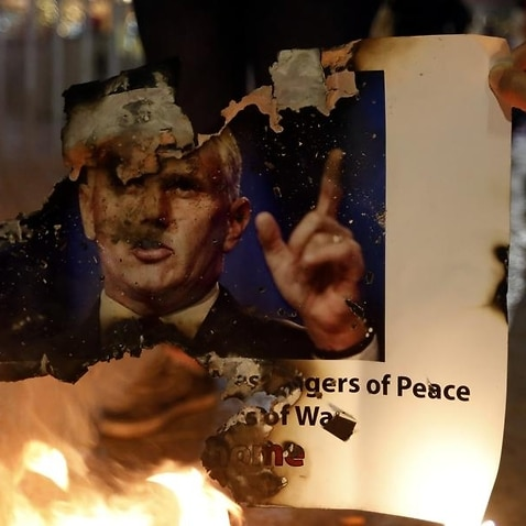 Palestinians burn posters of US Vice President Mike Pence