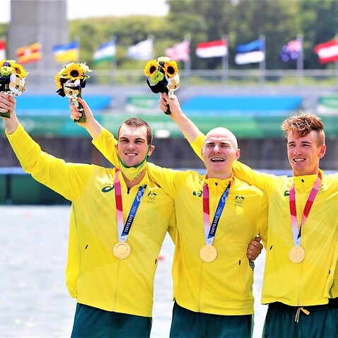 Members of the Australian rowing team celebrate after winning the men's four at the Tokyo Olympics on July 28, 2021, at Sea Forest Waterway.