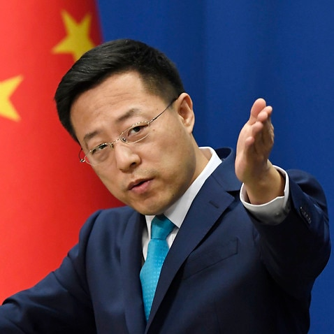 Chinese Foreign Ministry spokesman Zhao Lijian speaks at a press conference in Beijing on March 5, 2020. (Kyodo via AP Images) ==Kyodo