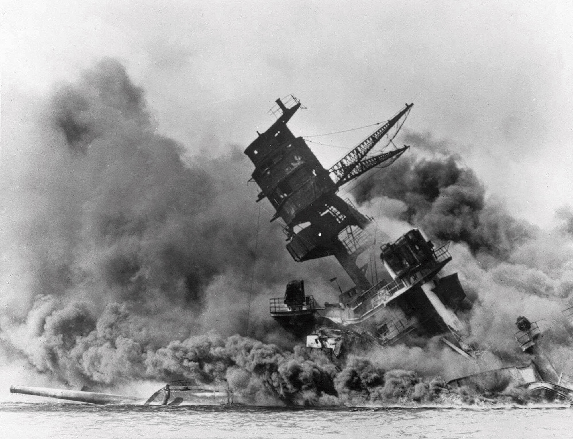 Smoke rises from the battleship USS Arizona as it sinks during the Japanese attack on Pearl Harbor, Hawaii.