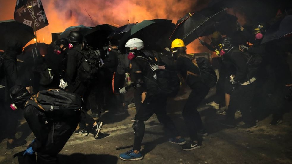 Footage shows daring escape by Hong Kong protesters on motorbikes