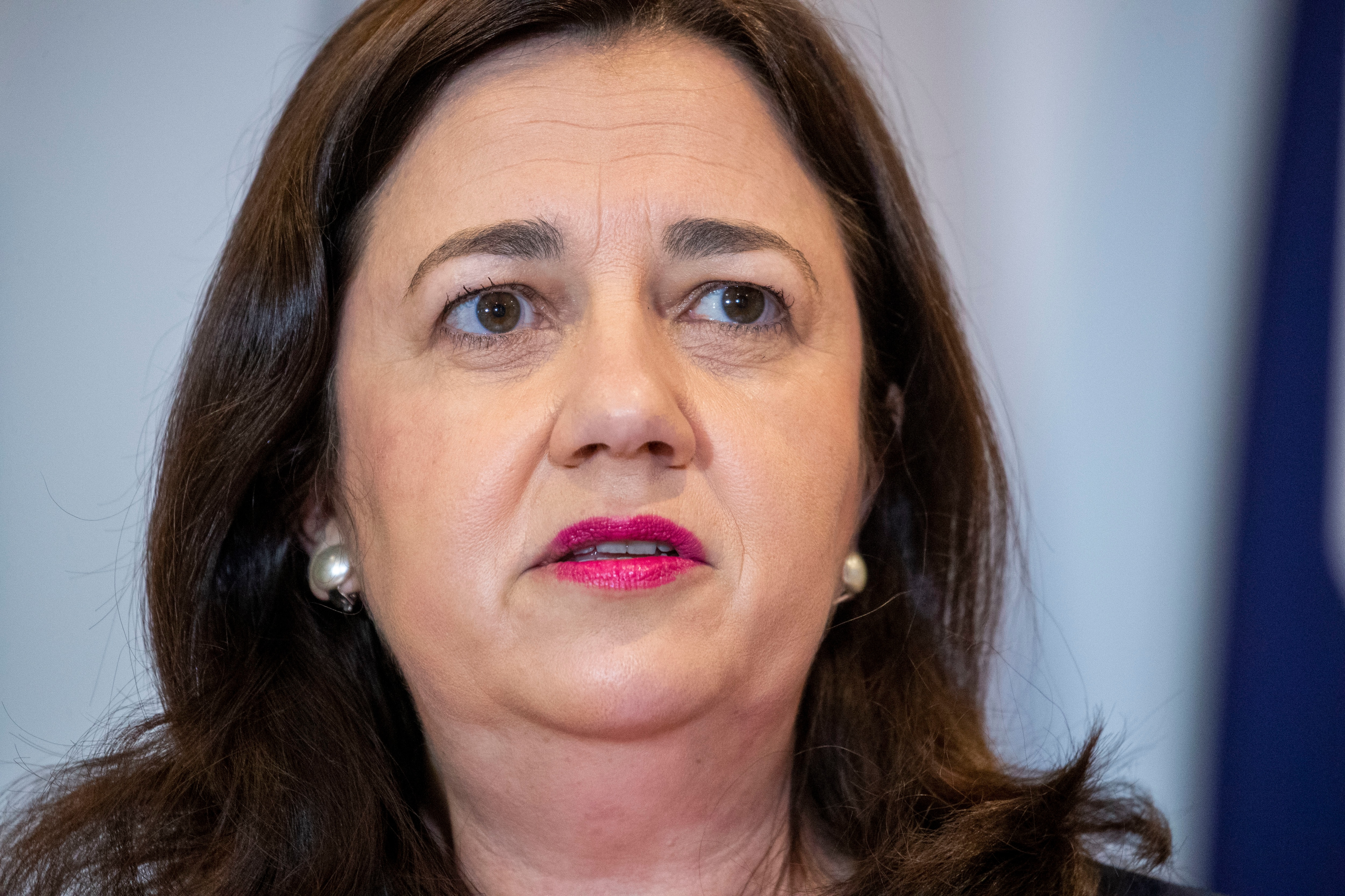 Queensland Premier Annastacia Palaszczuk urges travellers to delay plans if possible.