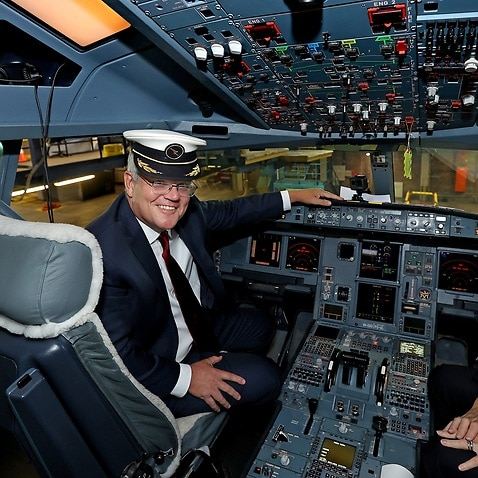 Scott Morrison and Qantas Pilot Captain Debbie Slade in the cockpit of an Airbus A330