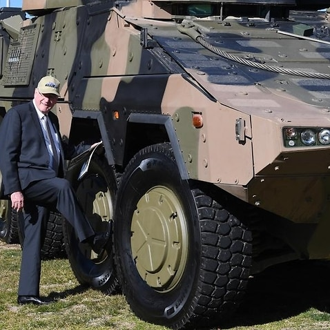 A file image of Queensland Senator Ian Macdonald with a Boxer CRV tank