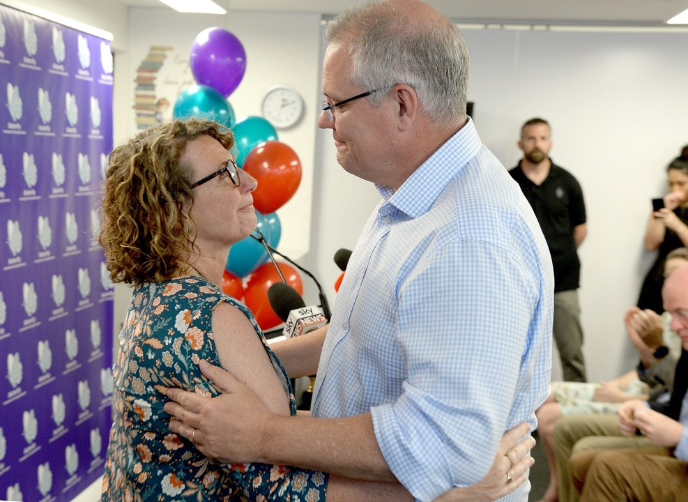 Prime Minister Scott Morrison with Fiona Ryan who lost her daughter Tess to an eating disorder.
