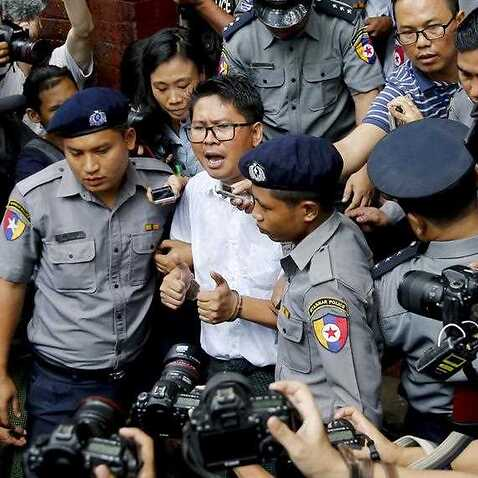 Reuters journalist Wa Lone is escorted out of the Insein township court in Yangon, Myanmar.