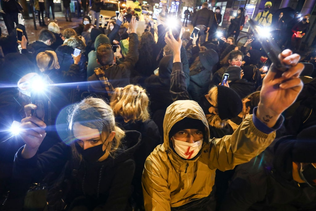 People demonstrate against restrictions on abortion law by blocking traffic in the centre of Krakow, Poland on 2 November.