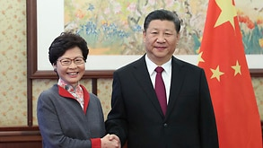 Hong Kong Chief Executive Carrie Lam, left, shakes hands with Chinese President Xi Jinping in Beijing, Friday, Dec. 15, 2017.