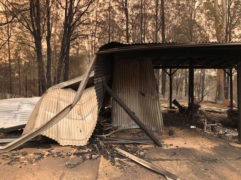 The Urunga Rural Fire Service saved Paul Sekfy's home, but his sheds were lost in the blaze.