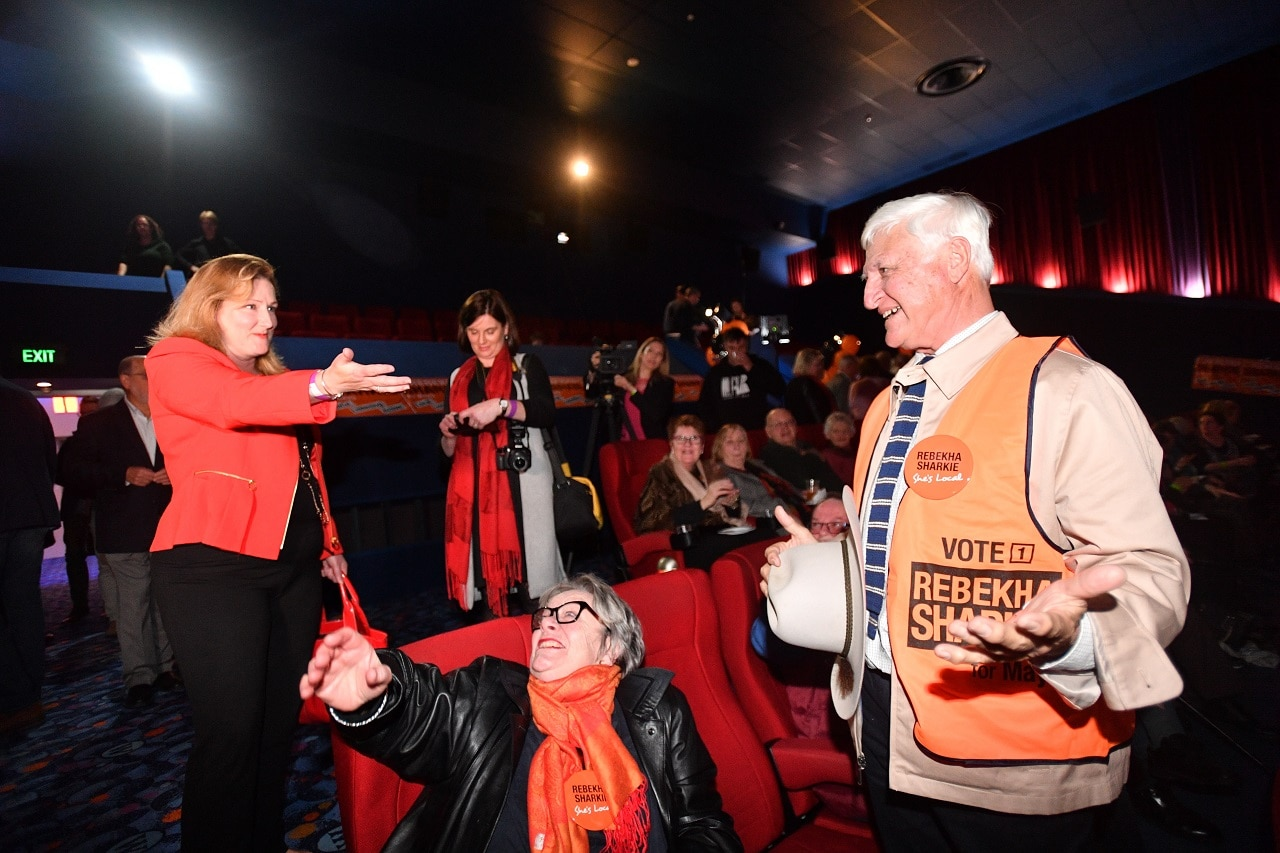 Centre Alliance candidate for Mayo, Rebekha Sharkie (left) reacts alongside Bob Katter MP (right) at the Mt Barker Wallis theatre in Adelaide, South Australia.