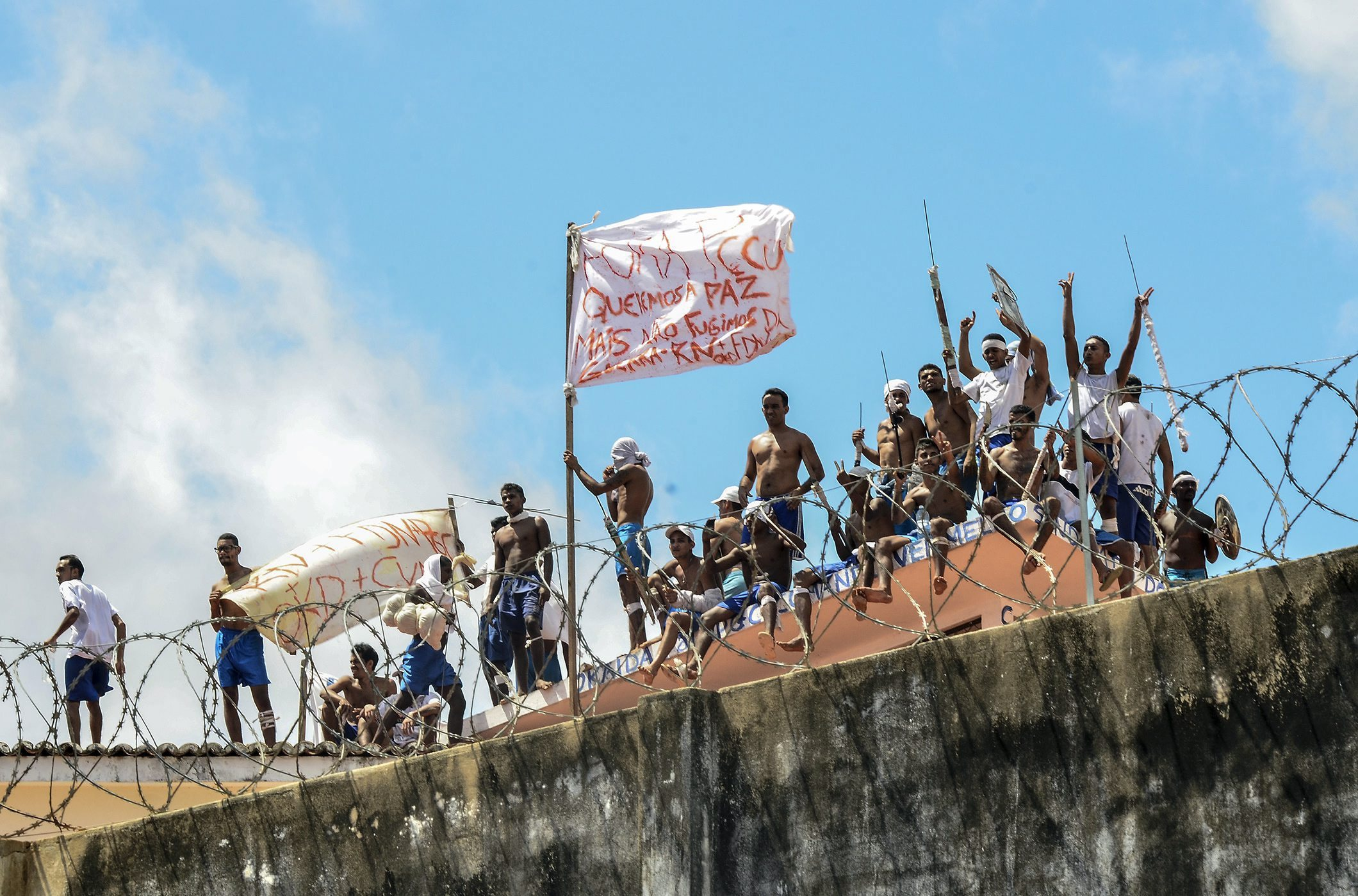 A group of inmates stand on a roof inside the State Penitentiary of Alcacuz in Nisia Floresta near Natal, Rio Grande do Norte, Brazil in January 2017.