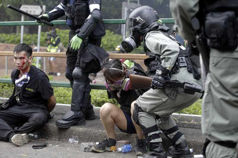 Riot police detain protesters near Hong Kong Polytechnic University in Hong Kong