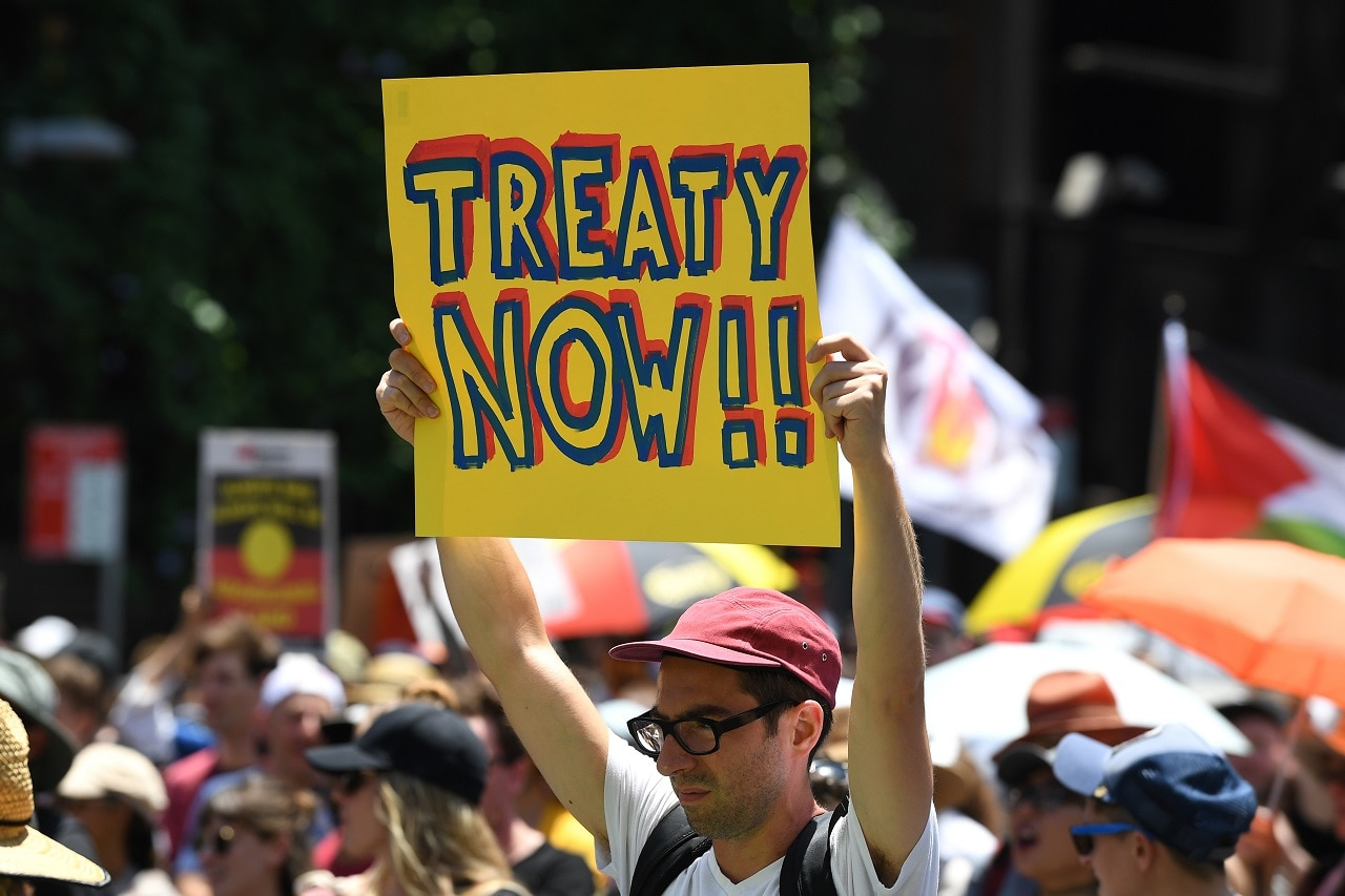 Protesters take part in an 'Invasion Day Rally' in Sydney.