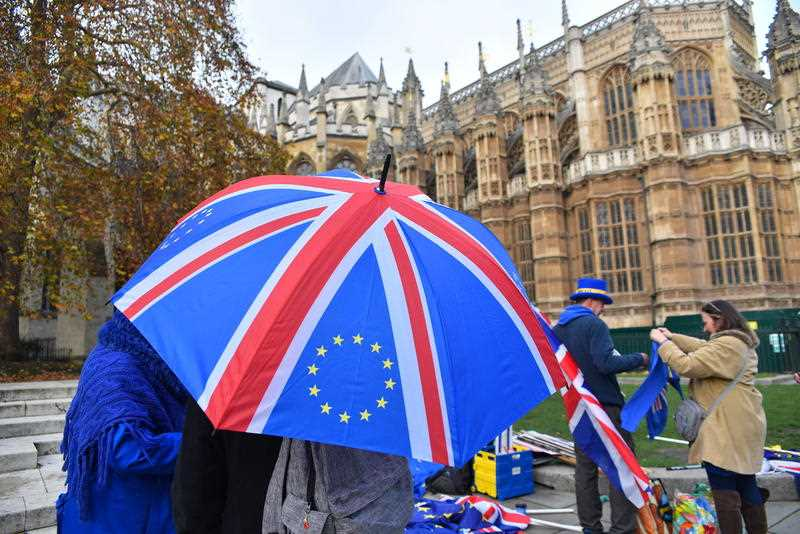 EU and Union flags are waved outside the Parliament to protest against Brexit.