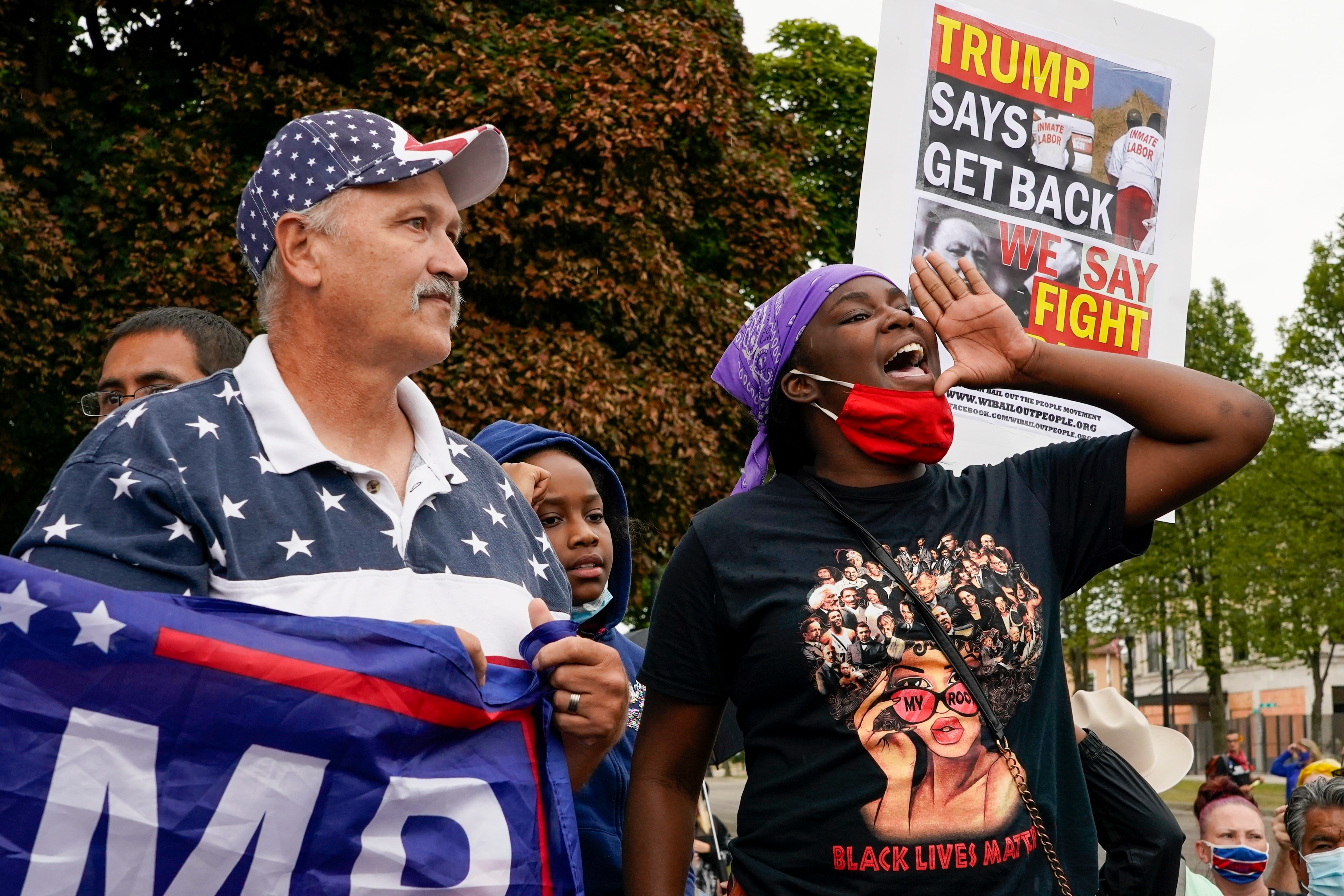 Supporters of both President Donald Trump and Black Lives Matters clash in a park outside the Kenosha County Courthouse