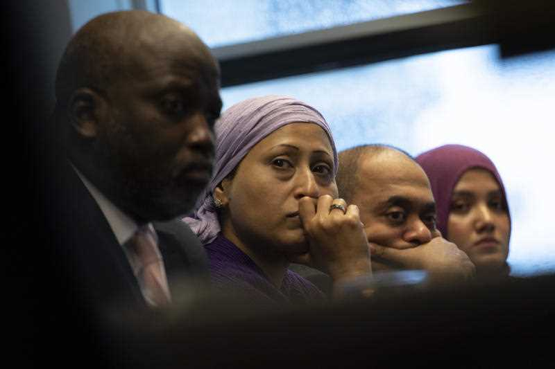 Representatives of the Rohingya community and Gambia's Justice Minister Aboubacarr Tambadou, left, listen to testimony during a press conference in The Hague