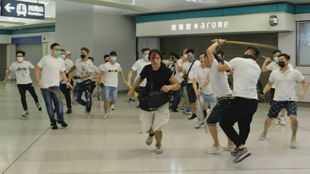 Men dress in white shirts have been filmed attacking protesters in Hong Kong. Vision on social media shows men wielding rods and beating demonstrators at Yuen Long MTR station.