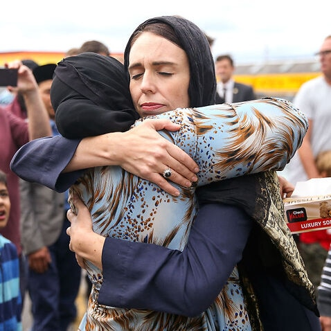 Jacinda Ardern hugs a mosque-goer at the Kilbirnie Mosque.