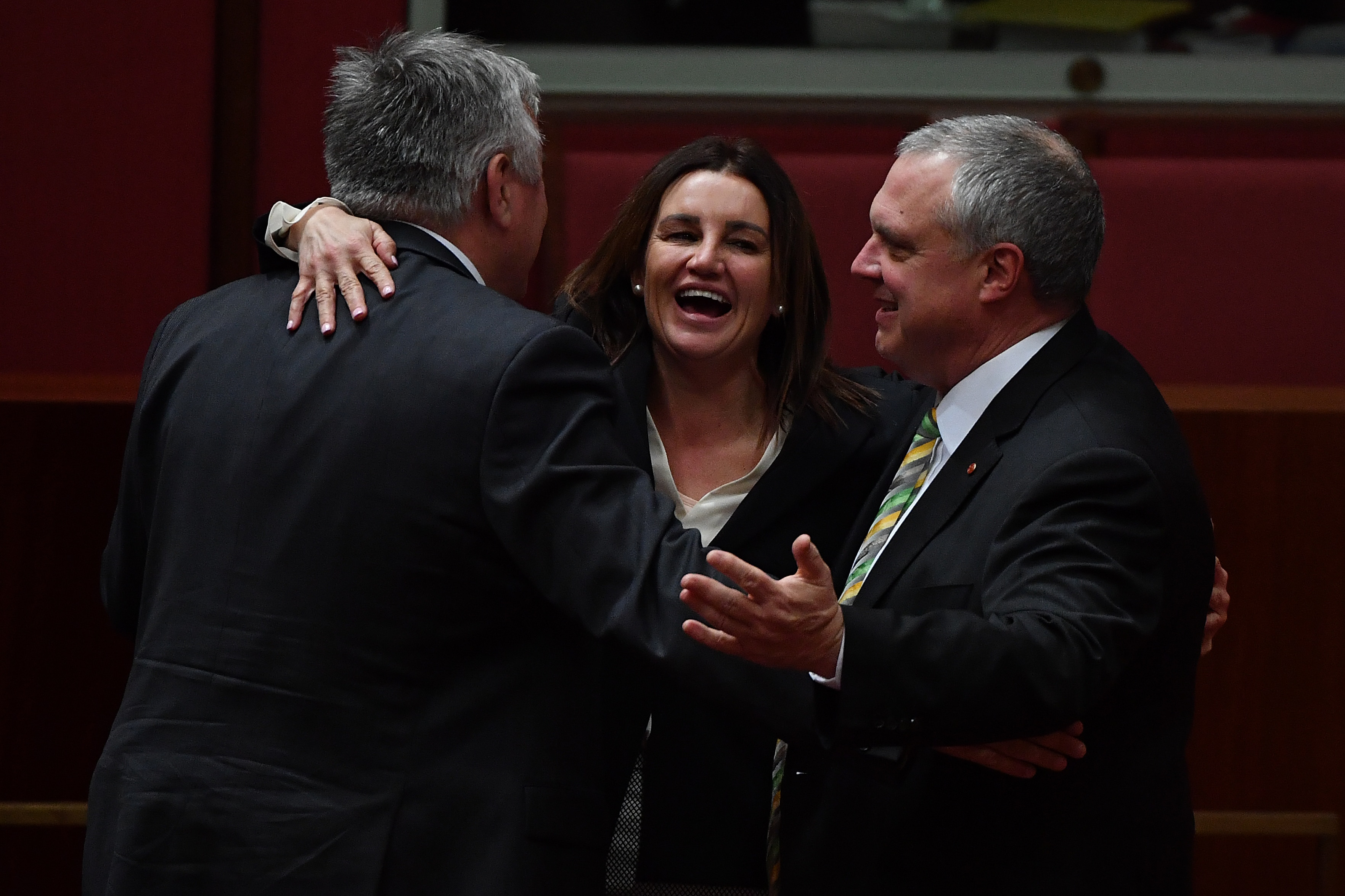 entre Alliance senators Rex Patrick and Stirling Griff and independent Senator Jacqui Lambie (centre) celebrate the end of the first sitting of Parliament.