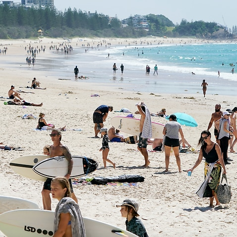 Crowds are seen at Burleigh Beach on the Gold Coast, Sunday, April 5, 2020