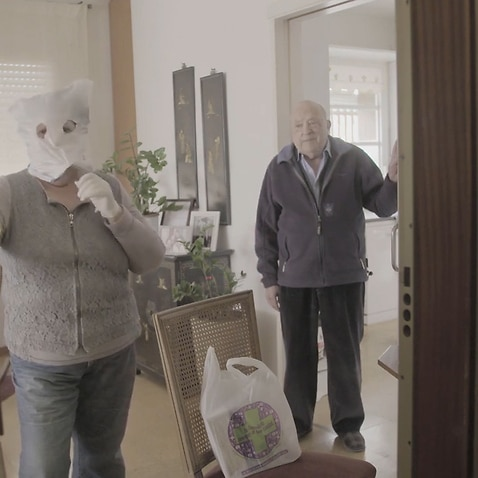 An elderly couple in Spain try to protect themselves from the coronavirus.