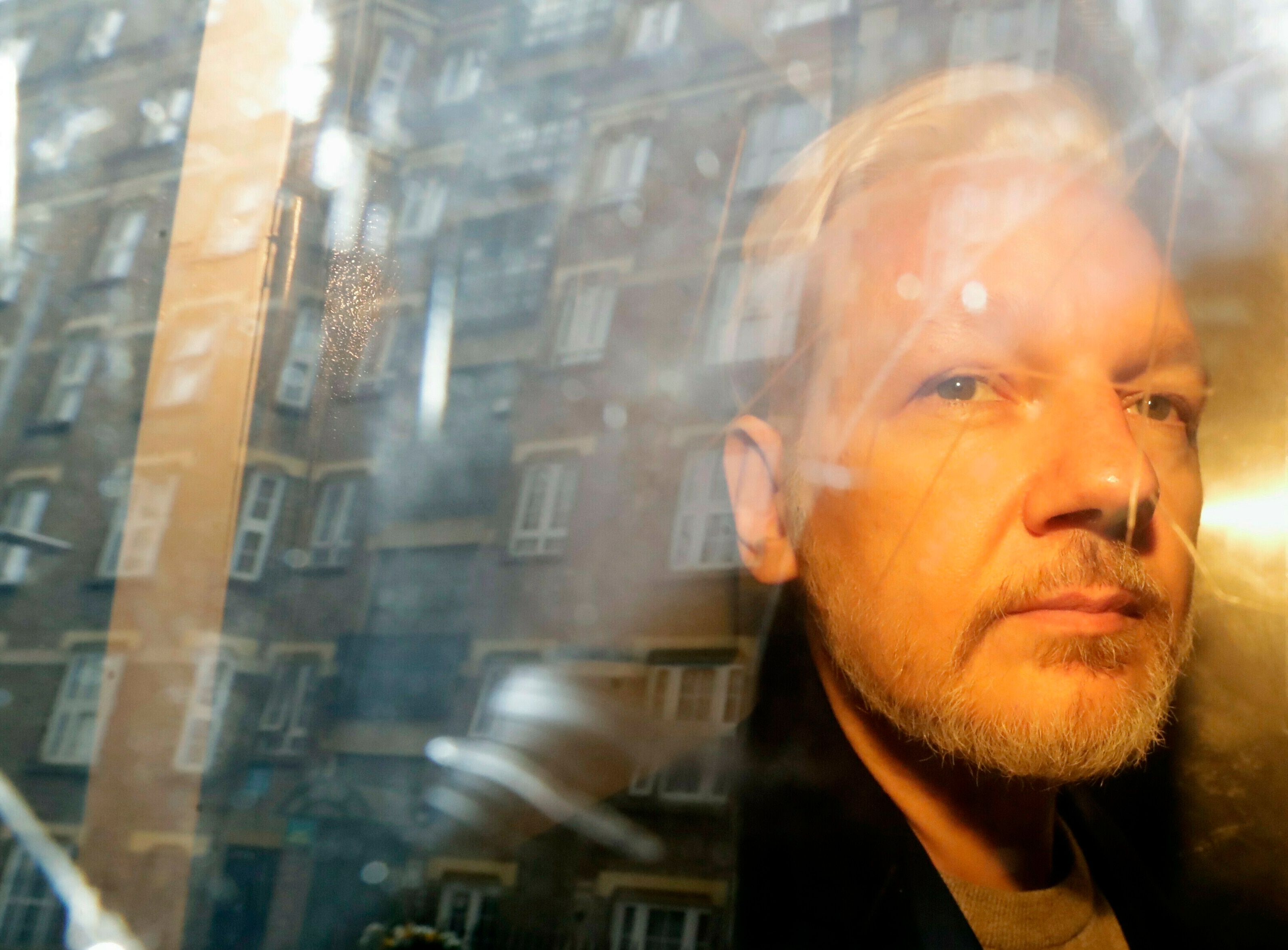 WikiLeaks founder Julian Assange is taken from court, where he appeared on charges of jumping British bail seven years ago, in London.