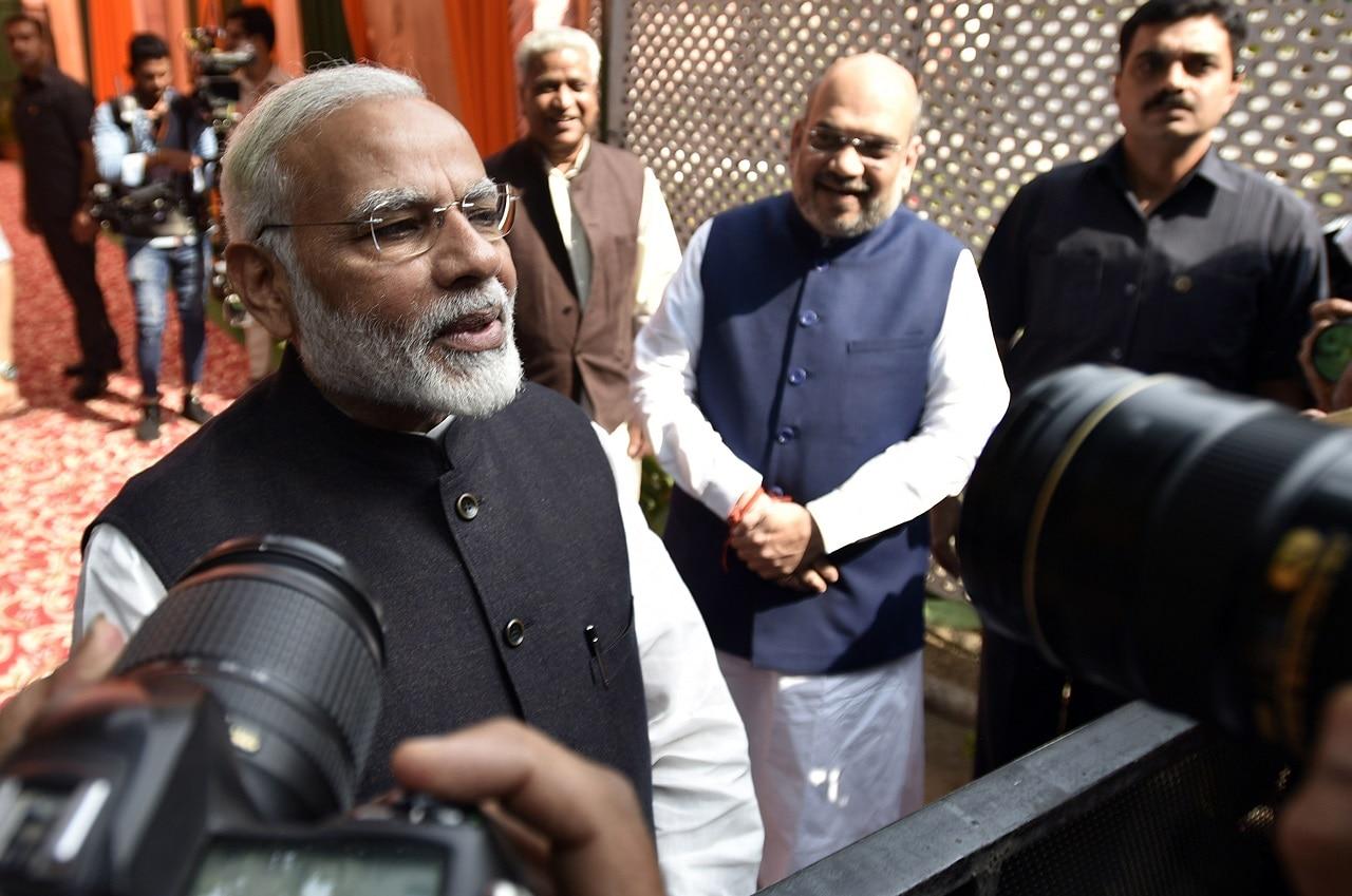 Prime Minister Narendra Modi talks to journalists.