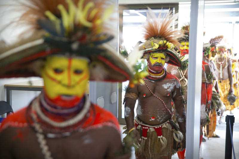 All eyes are on PNG this weekend. Performers in traditional dresses pass through a security screening at Jacksons International Airport in Port Moresby.