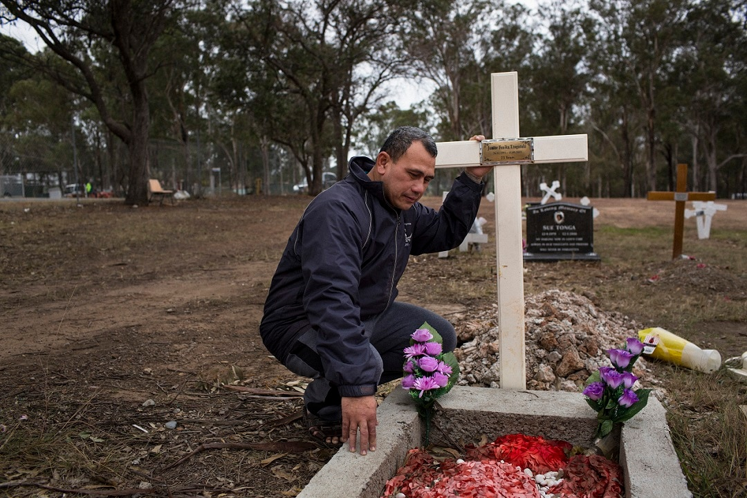 Vaea Togatuki visits the grave of his son Junior, who died in 2015 in an Australian prison, held by immigration officials after finishing his sentence, in Riverstone, Australia.