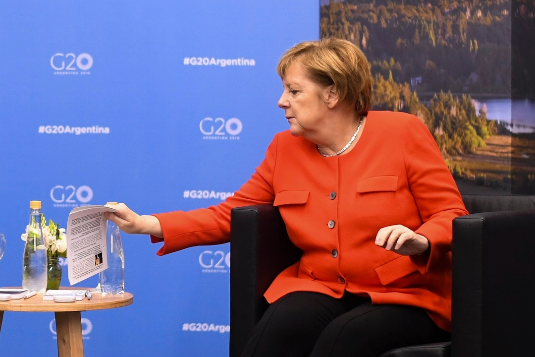 Chancellor of Germany Angela Merkel holds notes with information about her counterpart Australian Prime Minister Scott Morrison.