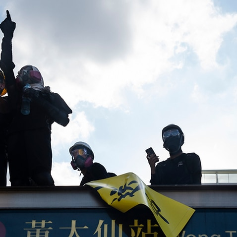 A protester points at the police during the demonstration in Hong Kong
