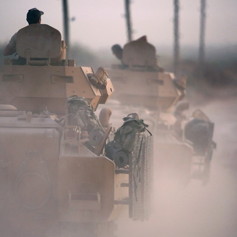Turkish soldiers with armored vehicles and tanks during a military operation in northern Syria.