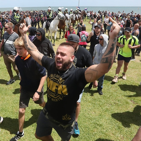 Ugly scenes at the St Kilda foreshore in Melbourne as far-right groups face off with anti-racism groups. Large group of police watch on.