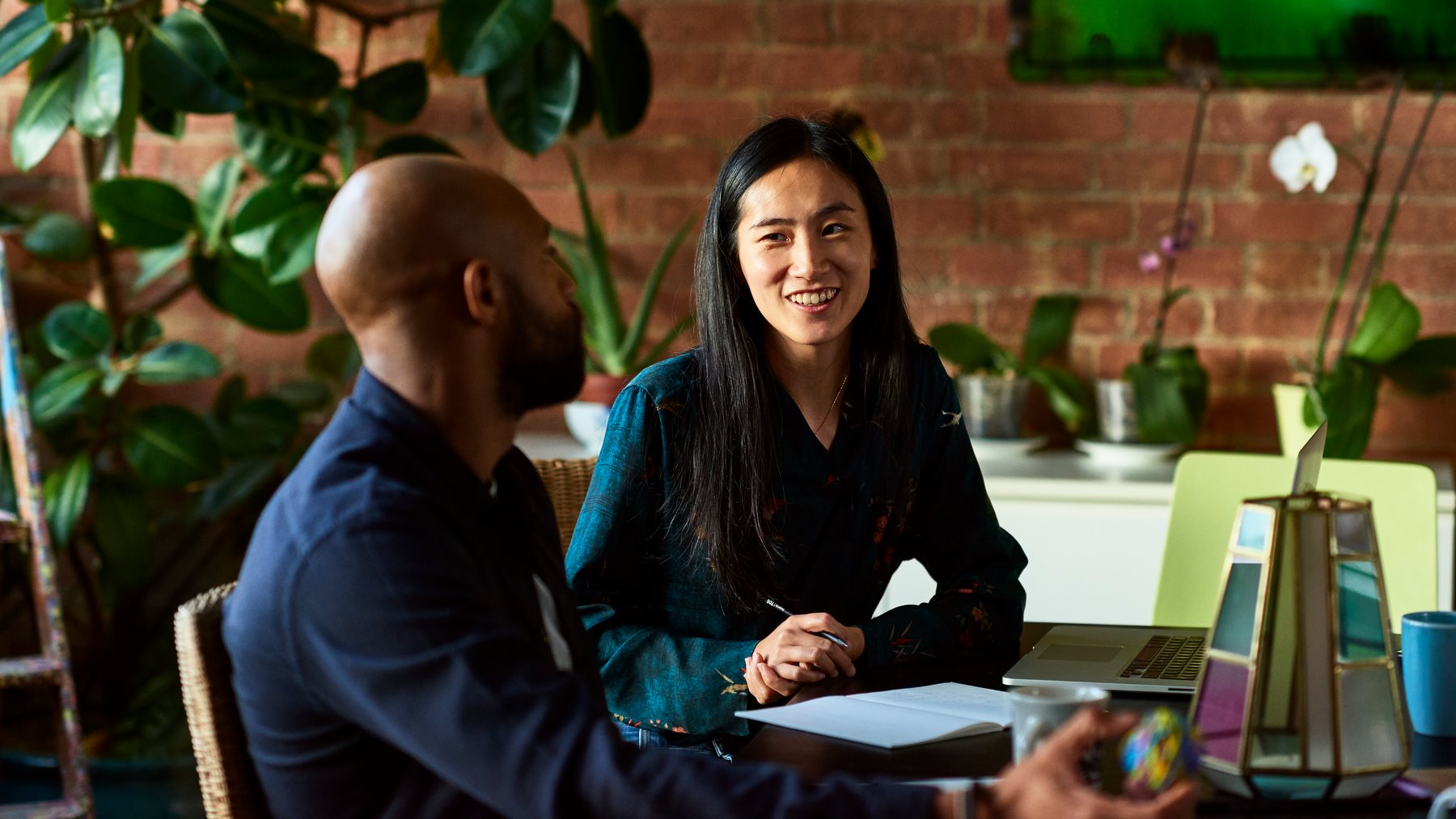 Woman smiling towards male colleague