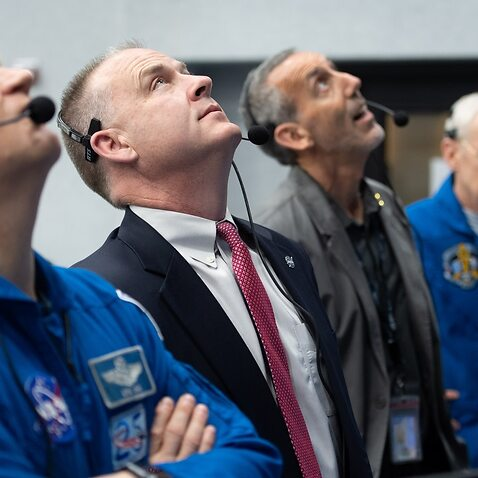 NASA astronaut Eric Boe (L) and Norm Knight, deputy director of flight operations at NASA's Johnson Space Center, watch the launch.