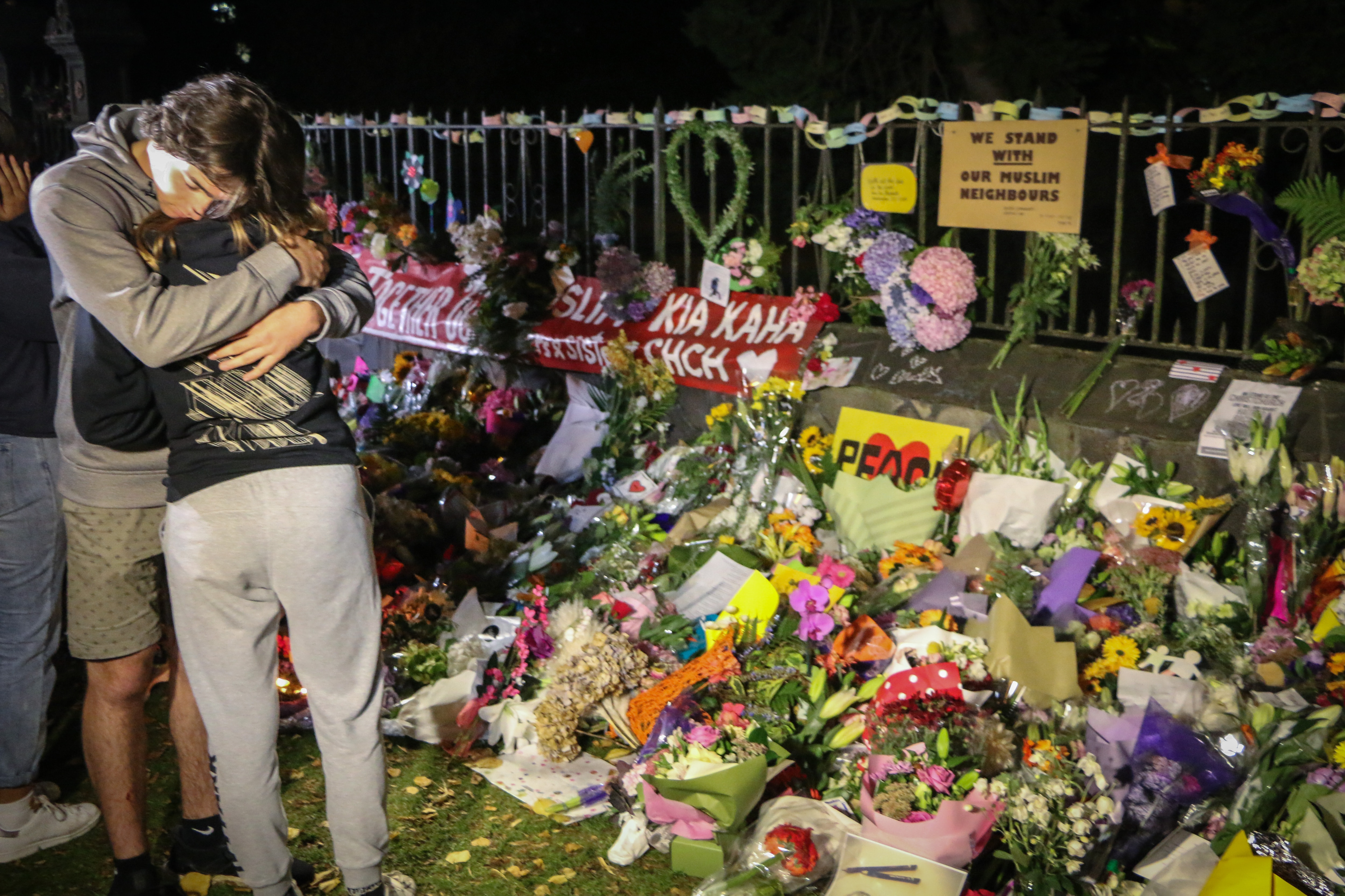 People seen comforting themselves while paying respect to the victims of the Christchurch mosques shooting.