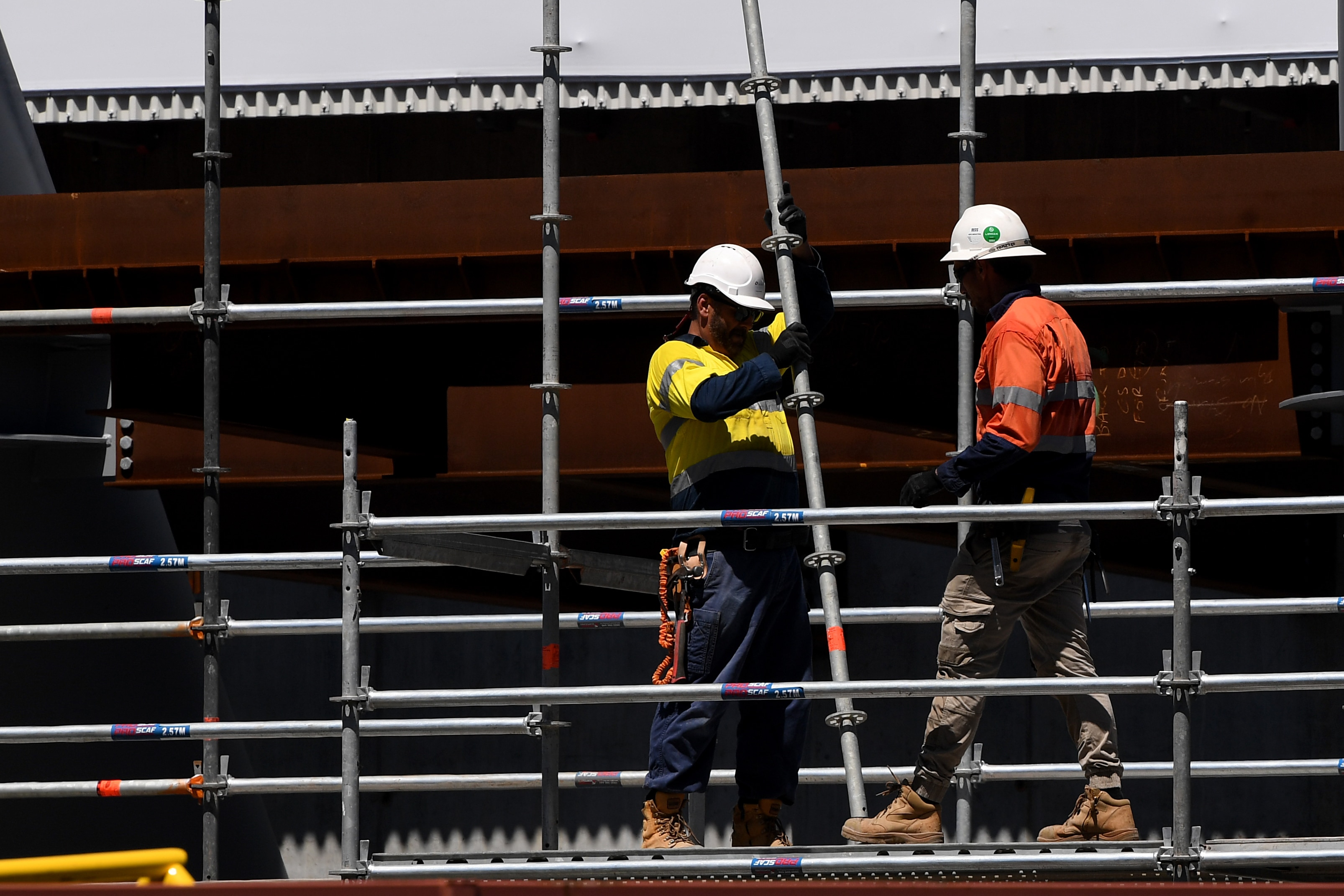 Workers seen at a construction site in Sydney in 2019