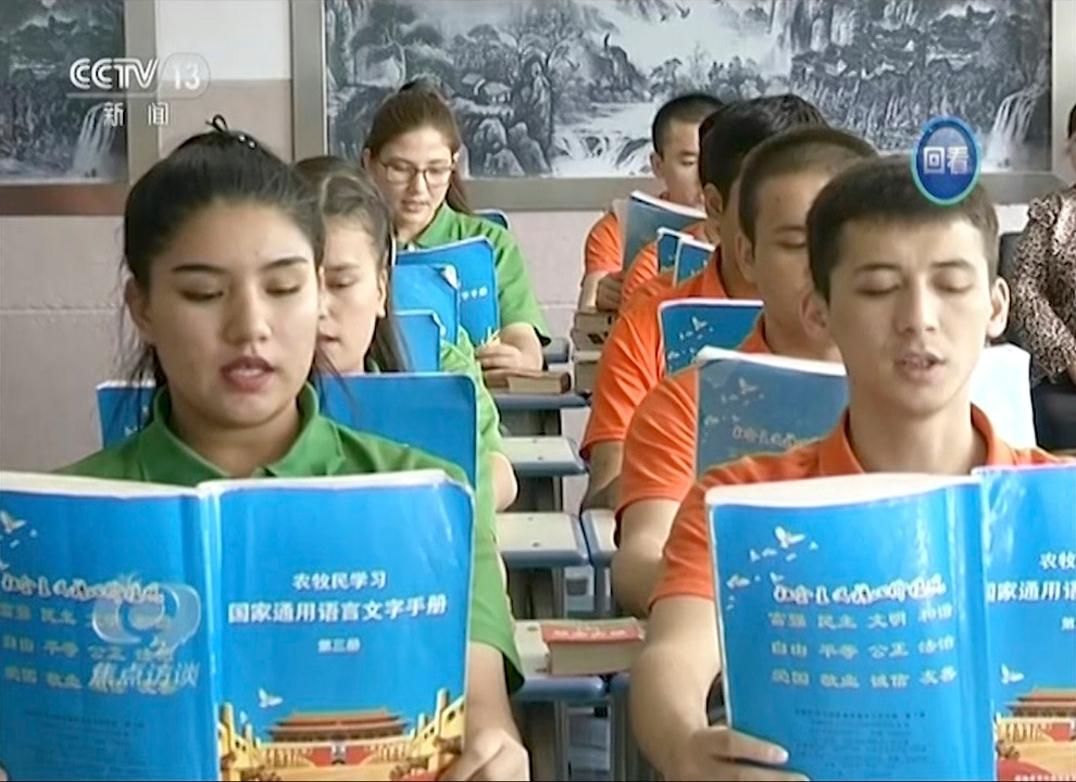 China maintains the centres for Uighur minorities are not camps but places of education and training as shown in this image from the country's state television.