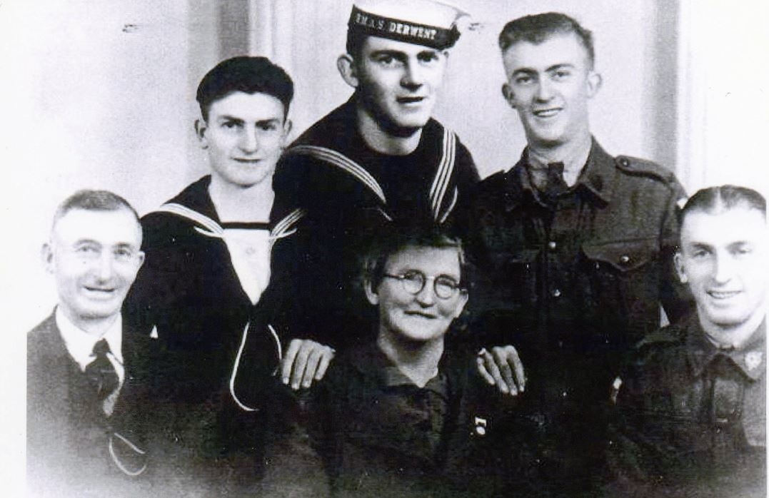 Studio portrait of the Sheean family. Teddy Sheean (back row, left) was born at Lower Barrington, Tasmania, on 28 December 1923.