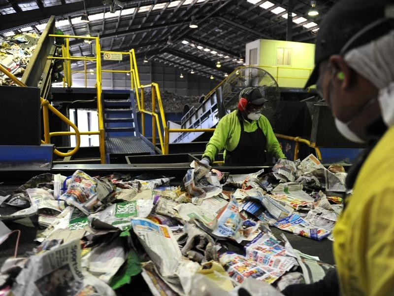 A file image of workers at the Visy recycling plant in Brisbane.
