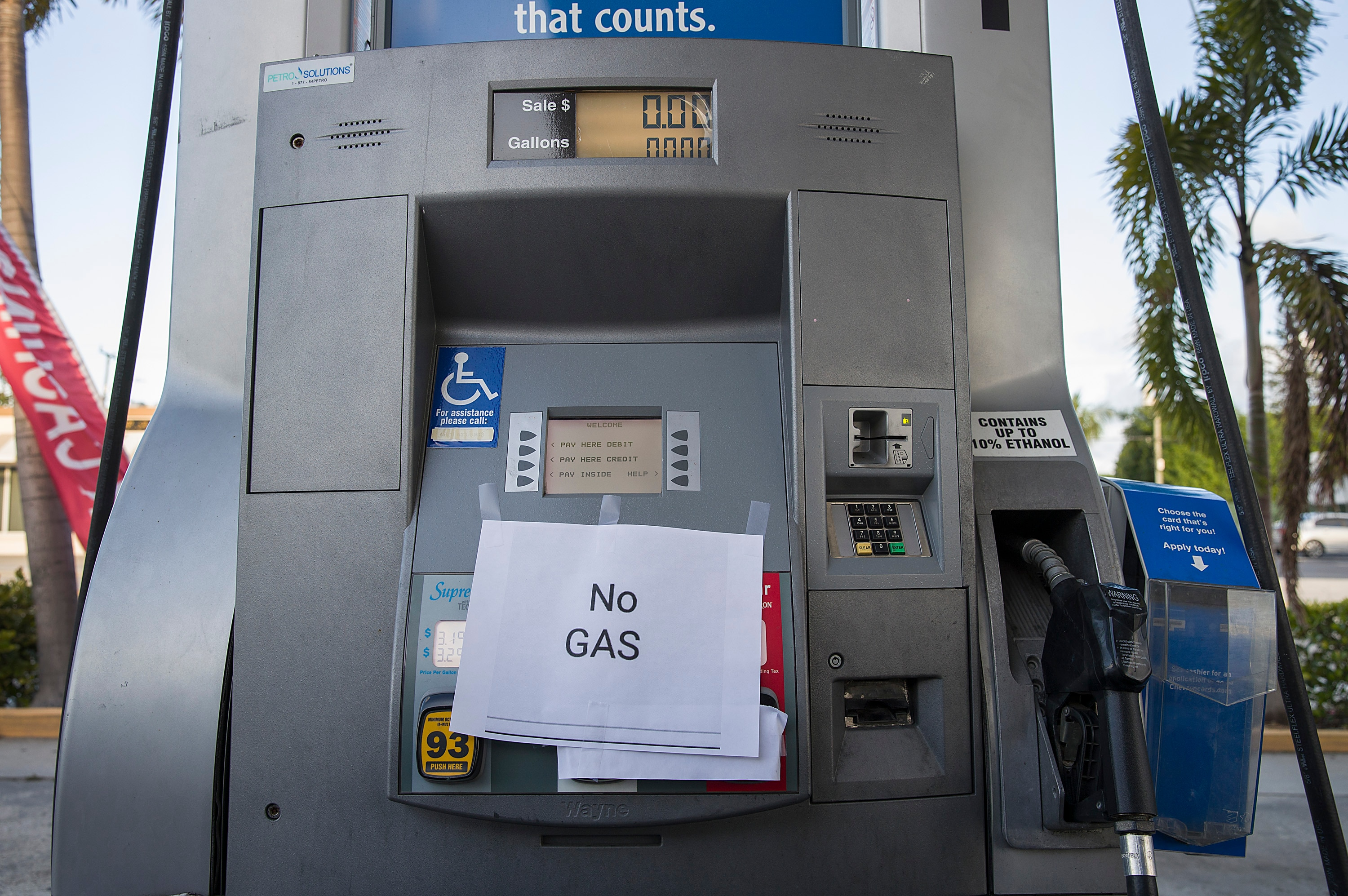 A 'No Gas' sign is seen on a gas pump at a station after it ran out of gas as people get fuel before the arrival of Hurricane Dorian.