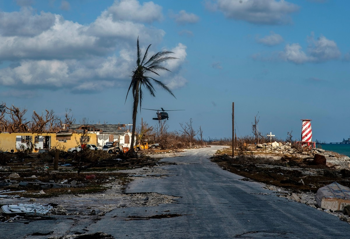 A helicopter flies over the village of High Rock after delivering emergency supplies in the aftermath of Hurricane Dorian In High Rock, Grand Bahama.