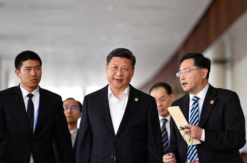China's President Xi Jinping (C) leaves an APEC meeting. There's been tense scenes this week as China and the US face off at the